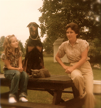 Dog on picnic table with cat and family - 1980's - thetemenosjournal.com