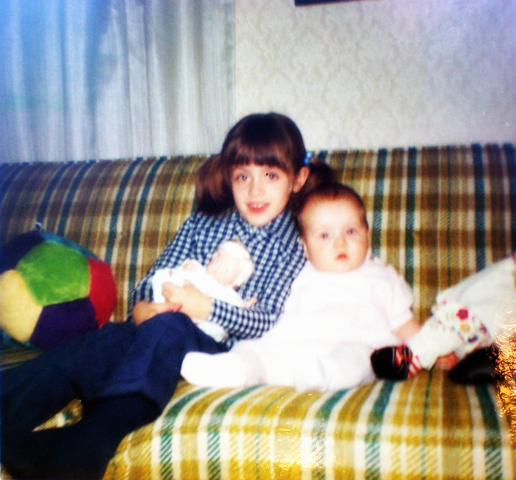 Sisters in the 70's - gold and green plaid sofa - thetemenosjournal.com