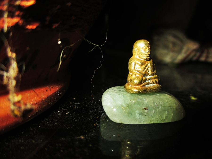Buddha On A Rock