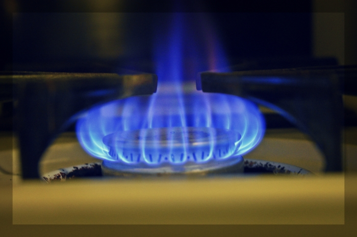 a flame from a gas stove - thetemenosjournal.com