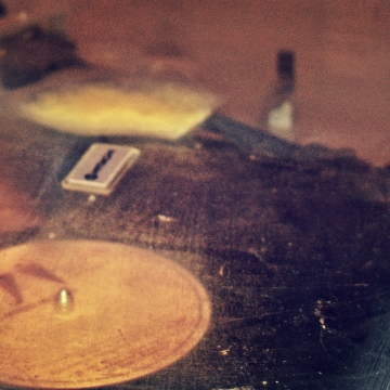 and old record player playing vinyl - thetemenosjournal.com