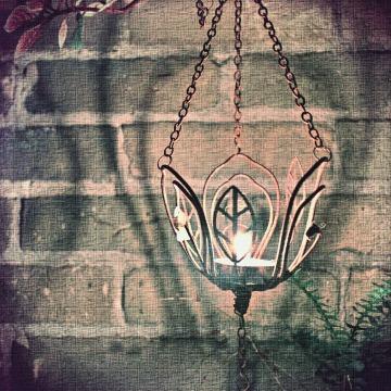candle light on brick wall - thetemenosjournal.com