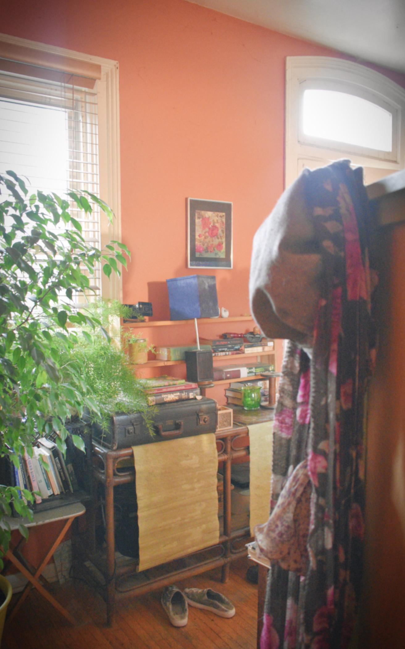 boho entranceway with orange walls - thetemenosjournal.com