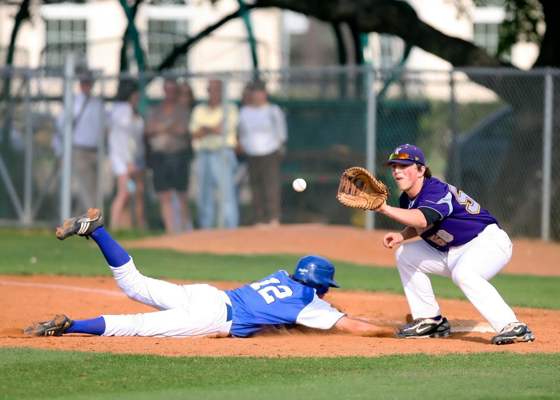 two man playing baseball during daytime