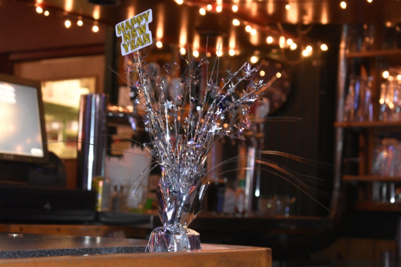 Happy New Years decor at a bar - thetemenosjournal.com
