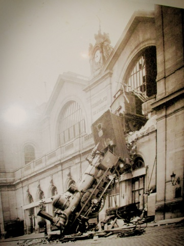 old train crashing out window of building