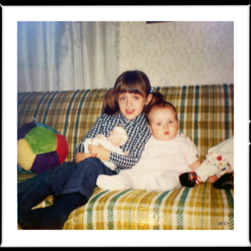 sisters on old 70s pukey green sofa